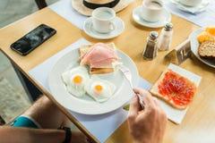 Morning breakfast, scrambled eggs, sandwich Stock Photo