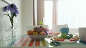 Morning breakfast table with bouquet of flower and plate with fruit royalty free stock image