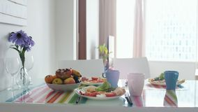 Morning breakfast table with bouquet of flower and plate with fruit stock photography