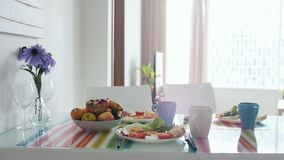 Morning breakfast table with bouquet of flower and plate with fruit stock photos
