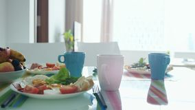 Morning breakfast table with plate of fruit stock photo