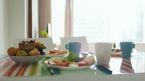 Morning breakfast table with plate of fruit royalty free stock images