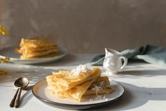 Morning, breakfast - traditional russian blini pancakes, french crepes whipped cream, mimosa flower stock image