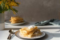 Morning, breakfast - traditional russian blini pancakes, french crepes whipped cream, mimosa flower. Morning, breakfast - traditional russian blini pancakes royalty free stock images