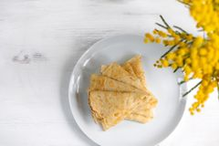 Morning, breakfast - traditional russian blini pancakes, french crepes, white table, top view. Morning, breakfast - traditional russian blini pancakes, french stock photo