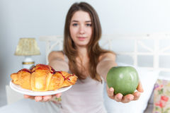 The morning and breakfast of young beautiful girl Stock Photos