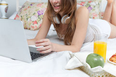 The morning and breakfast of young beautiful girl Stock Images