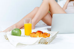 The morning and breakfast of young beautiful girl Stock Image