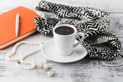 Morning brearfast on table with bijouterie and coffee cup Stock Photos