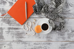 Morning brearfast on table with bijouterie and coffee cup Stock Image