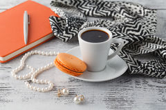 Morning brearfast on table with bijouterie and coffee cup Royalty Free Stock Image