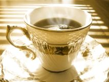 Morning brew. I love this one. It was taken in the morning. The morning sun peeking through the window. I have given it a septa tone and some hot steam Royalty Free Stock Images