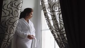 Morning of the bride, a beautiful woman in a white dress is preparing for the wedding, slow motion stock video