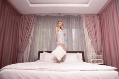 Morning bride. girl lying on a bed Stock Photo