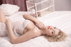 Morning bride. girl lying on a bed Royalty Free Stock Photos