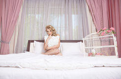 Morning bride. girl lying on a bed Stock Photos