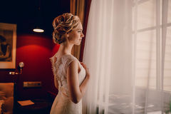 Morning bride in hotel room Royalty Free Stock Photo