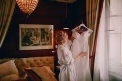 Morning bride in hotel room Stock Photo