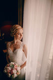 Morning bride in hotel room Stock Images
