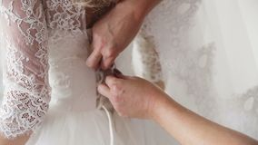 Morning bride. the bride prepare for the wedding, lace up the dress. stock video footage