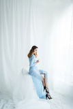 Sweet bride in an blue gown. Morning bride`s dresses in a gently blue dressing gown Royalty Free Stock Images