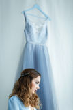 Sweet bride in an blue gown Stock Photos