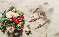 Morning bride shoes bouquet bridal veil. Morning bride conceptual shoes bouquet bridal veil Stock Photography