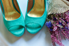 Morning of the bride. Wedding accessories and turquoise shoes Stock Images