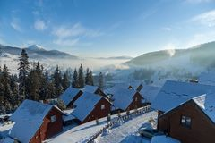 A morning is in Bukovel. Winter landscape in mountains skiing resort of Bukovel,houses, hotels, shops and roads in Bukovel stock images