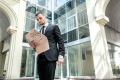 Morning business news. Business man formal wear standing in down Stock Image