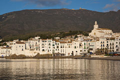 Morning in Cadaques Spain. Early morning sunlight reflecting off the white picturesque buildings of Cadaques Spain Royalty Free Stock Photos