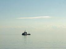 Morning calm sea with the ship Stock Images