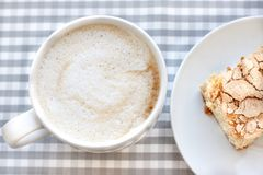 Morning cappucсino coffee and homemade cake pastries. On background in cell stock photography