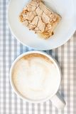 Morning cappucсino coffee and homemade cake pastries. On background in cell Royalty Free Stock Photo