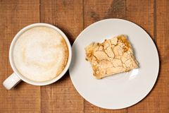 Morning cappucсino coffee and homemade cake pastries. On wooden background Royalty Free Stock Images