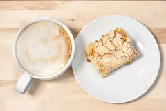 Morning cappucсino coffee and homemade cake pastries. On wooden background Stock Photo