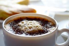 Morning cappuccino and bun Royalty Free Stock Photos