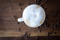 Morning Cappuccino. Morning coffee on a warm walnut wood table Royalty Free Stock Image