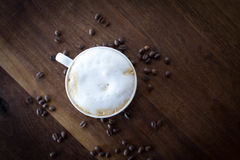 Morning Cappuccino. Morning coffee on a warm walnut wood table Stock Photos