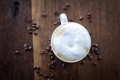 Morning Cappuccino. Morning coffee on a warm walnut wood table Stock Images