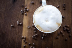 Morning Cappuccino. Morning coffee on a warm walnut wood table Stock Image