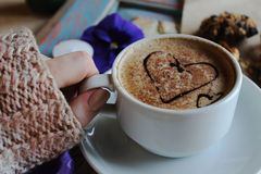 Morning cappuccino with hearts, with cookies and flowers.  royalty free stock images