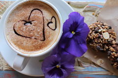 Morning cappuccino with hearts, with cookies and flowers.  stock photos