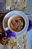 Morning cappuccino with hearts, with cookies and flowers.  Stock Images