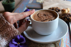 Morning cappuccino with hearts, with cookies and flowers.  Stock Image