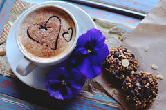 Morning cappuccino with hearts, with cookies and flowers.  royalty free stock image