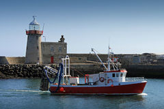 Morning Catch Howth Harbour. A trawler entering Howth harbour after a mornings fishing Royalty Free Stock Photo