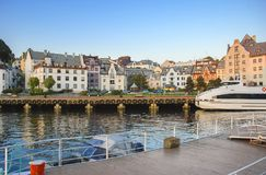 Morning at central marina of Alesund, Norway. Alesund is a famous resort and tourist city in Scaninavia Stock Photos