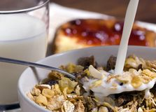 Morning Cereal pouring the milk Royalty Free Stock Photography