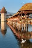 Morning Chapel Bridge in Luzern. Wonderful morning view on Chapel Bridge and Water Tower in Luzern, Switzerland Royalty Free Stock Photo